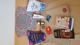 Bath salts, oils and cream for massage, painkillers and anti-inflammatory tablets, heat pad (of course), and things to nourish my mind and soul (books, movies, music and dark chocolate)
