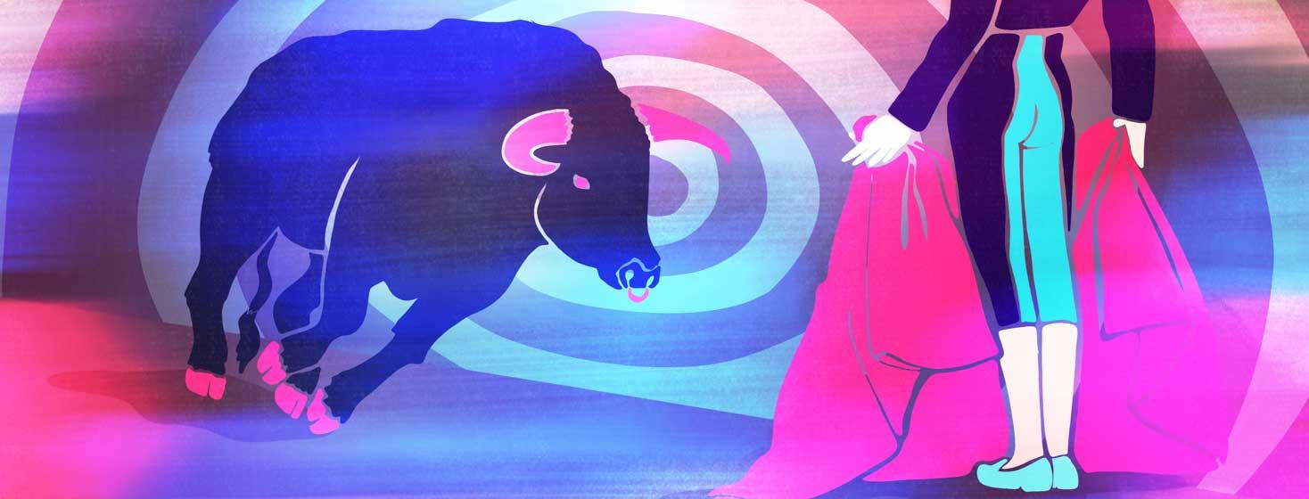 A bull running at a bullfighter