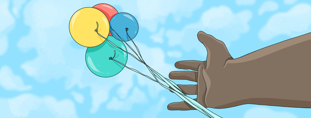 A hand of a person with axial spondyloarthritis lets go of a bunch of balloons into the sky.