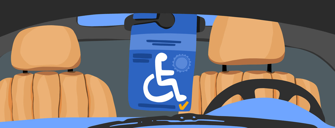 A look at the inside of a car, showing a handicapped tag hanging from the rearview mirror, which can help with axial spondyloarthritis management.