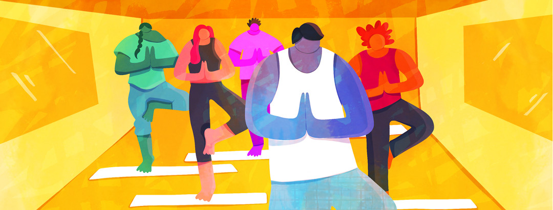 A man leading a group of people in a yoga flow, which can help with axial spondyloarthritis symptoms.