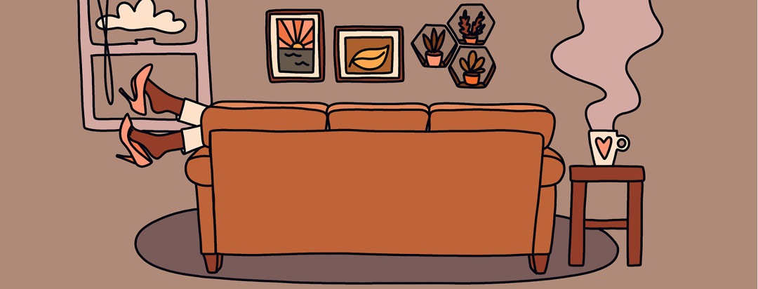 The back view of a couch in a living room, showing legs draped over the side, feet kicking off high heels and a relaxing cup of coffee on the side table.