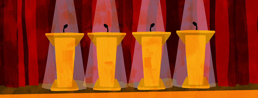 Four podiums are lined up on a stage.