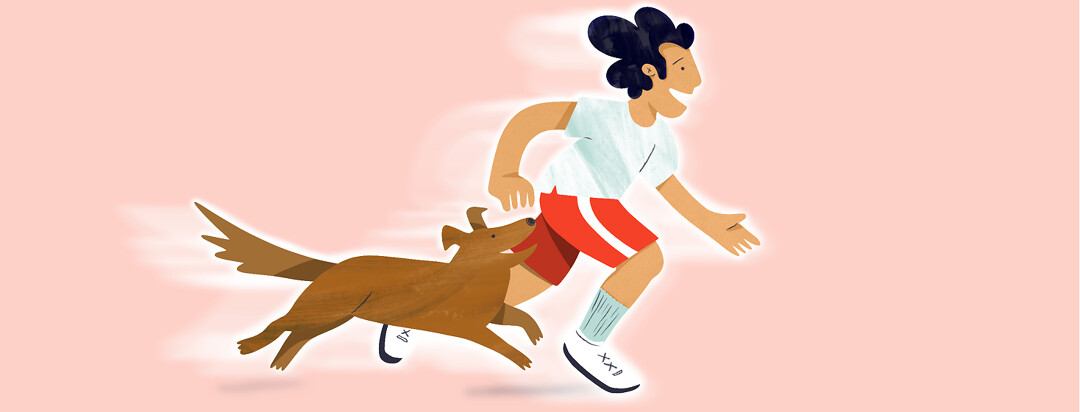 A guy runs happily with his dog running alongside him.