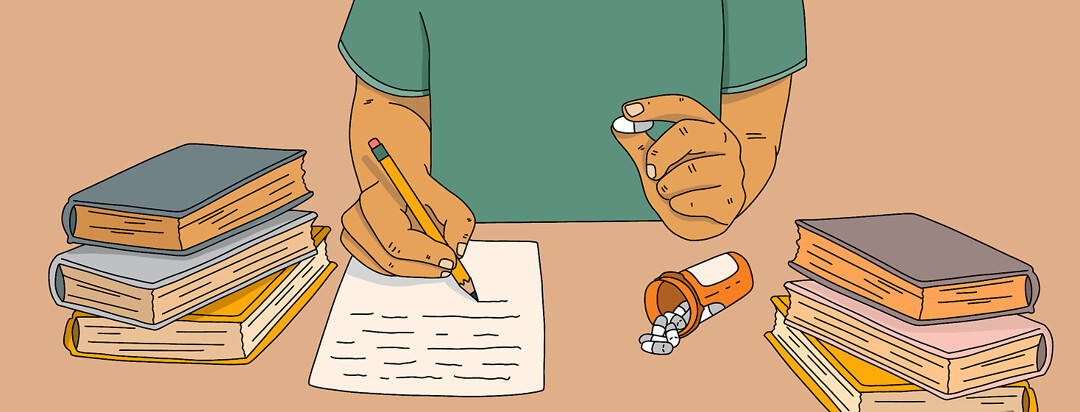 A person sits at a desk, writing a paper with their right hand, and holding a pill with their left.