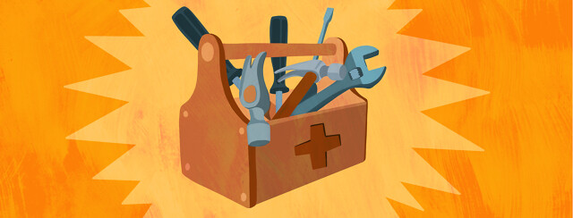 A toolbox with a medical cross on the side and tools spilling out of it.
