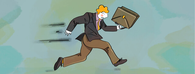 A business man dressed in business attire and running with his briefcase.