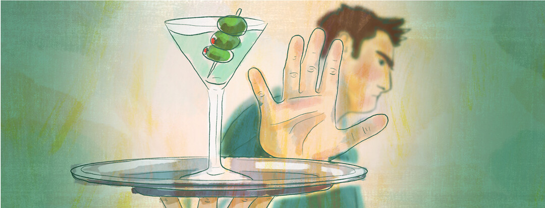 A man holds a hand up to a martini being presented to him on a silver platter.